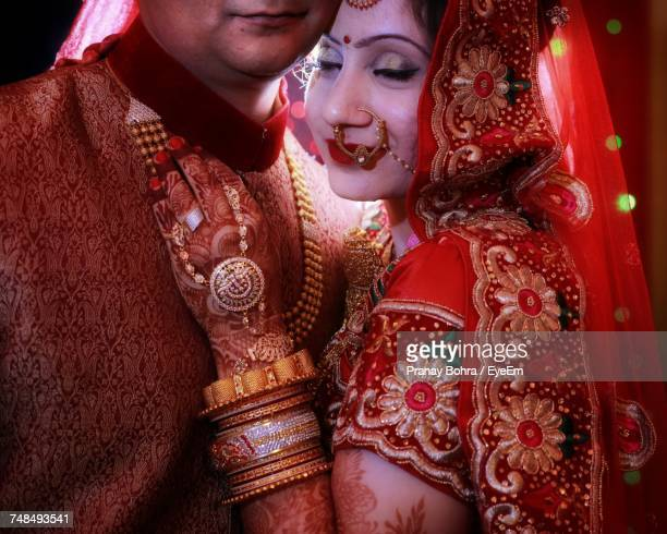 midsection of beautiful bride embracing groom - indian bohra stock pictures, royalty-free photos & images