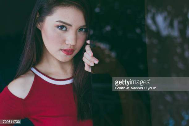 Midsection Of Beautiful Young Asian Woman With Red Shirt