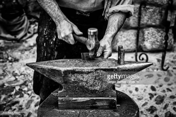 midsection of blacksmith working in workshop - strike industrial action stock pictures, royalty-free photos & images