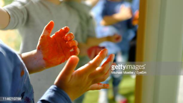 midsection of boy with paint on hand - michael stock photos and pictures