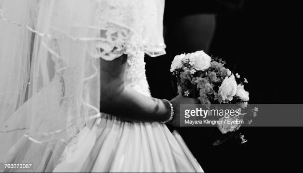midsection of bride holding bouquet - marriage stock pictures, royalty-free photos & images