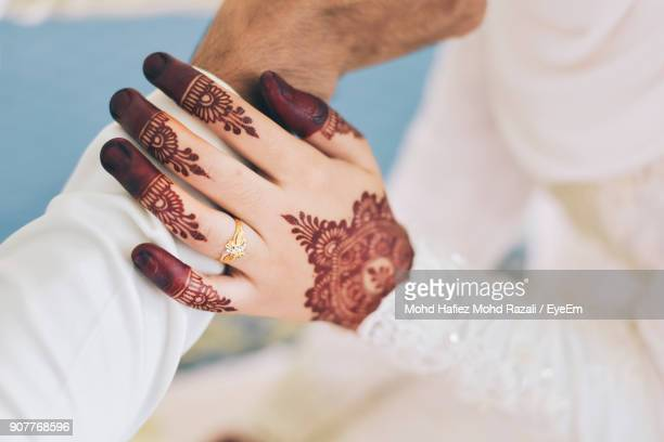 Midsection Of Bride Holding Bridegroom Hand During Wedding