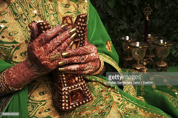 Midsection Of Bride Holding Decoration During Wedding