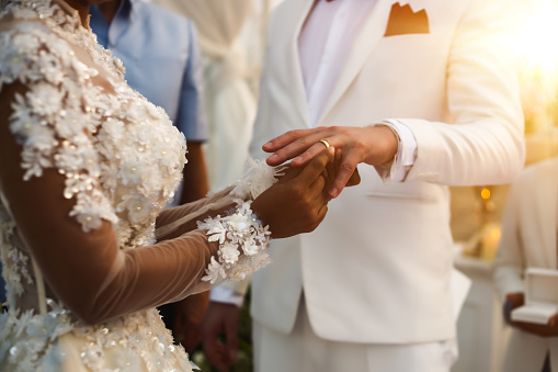 Midsection Of Bride Putting Ring In Groom Finger At Ceremony - gettyimageskorea