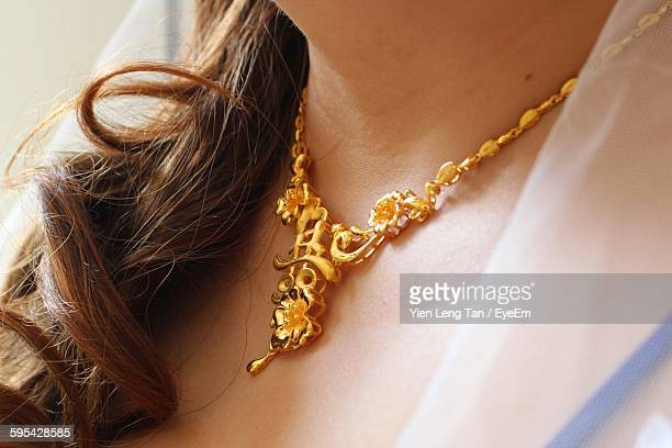 midsection of bride wearing gold necklace - necklace stock pictures, royalty-free photos & images
