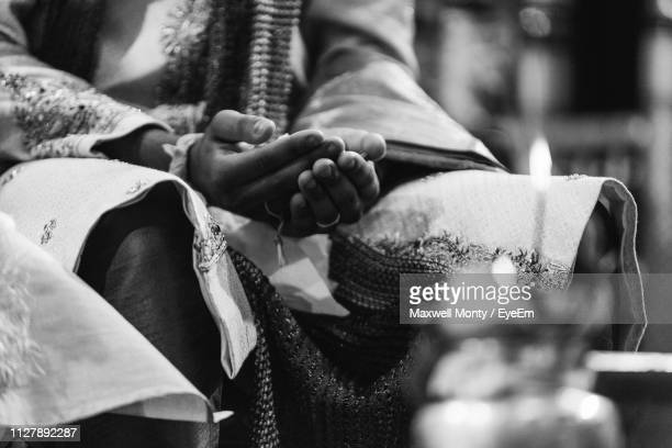 midsection of bridegroom wearing wedding dress during ceremony - hinduism stock pictures, royalty-free photos & images
