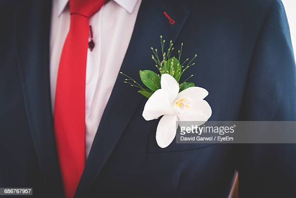 Midsection Of Bridegroom With Flower In Pocket