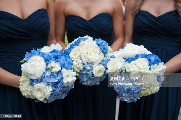 midsection of bridesmaid holding bouquets - bridesmaid stock pictures, royalty-free photos & images