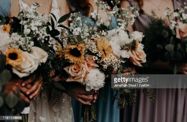 midsection of bridesmaids holding bouquet - bridesmaid stock pictures, royalty-free photos & images