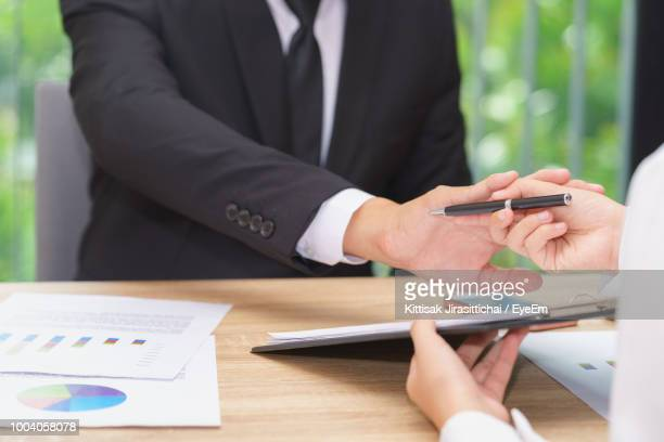 midsection of business people at desk - veto stock pictures, royalty-free photos & images