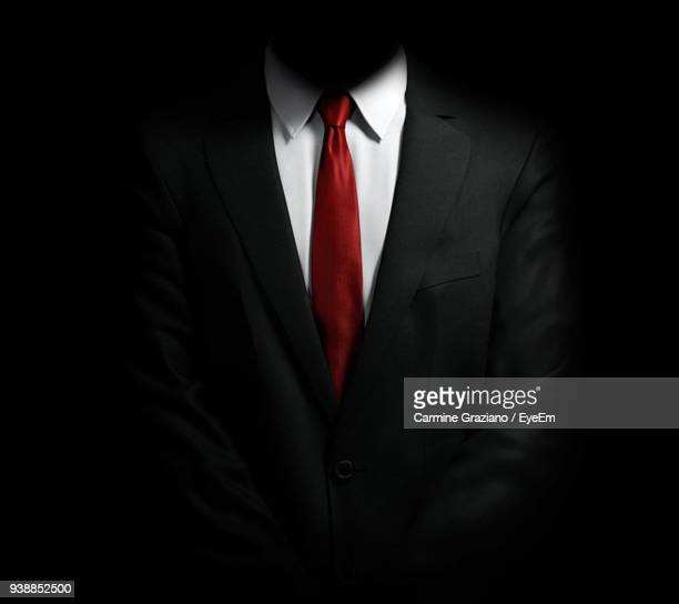 Midsection Of Businessman Against Black Background