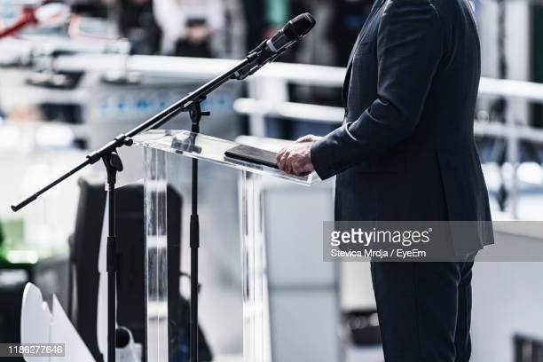 midsection of businessman giving speech - politician stock pictures, royalty-free photos & images