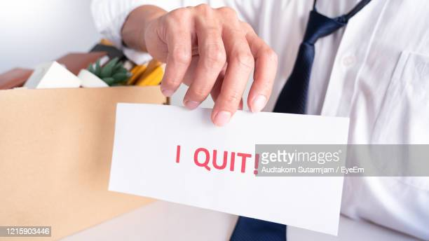 midsection of businessman holding resignation letter - quitting a job stock pictures, royalty-free photos & images