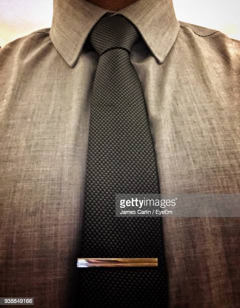 midsection of businessman wearing necktie - collar stock pictures, royalty-free photos & images