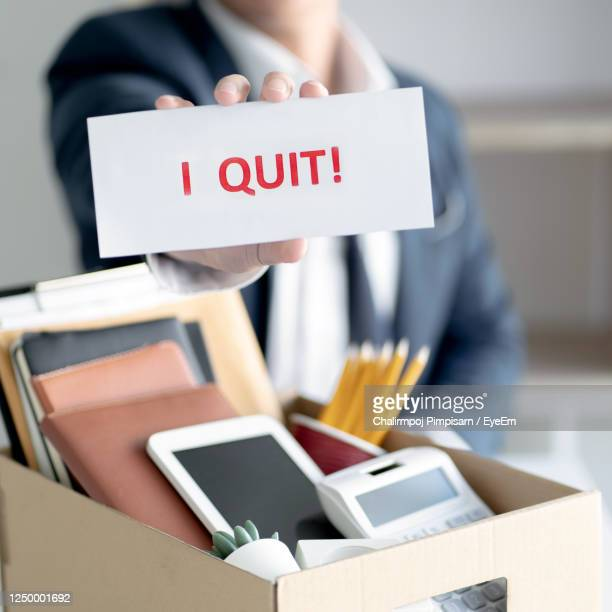 midsection of businesswoman holding text in office - quitting a job stock pictures, royalty-free photos & images