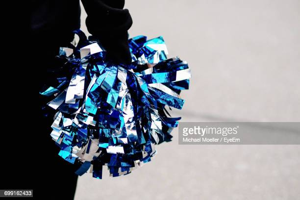 midsection of cheerleader holding pom-pom - black cheerleaders stock photos and pictures
