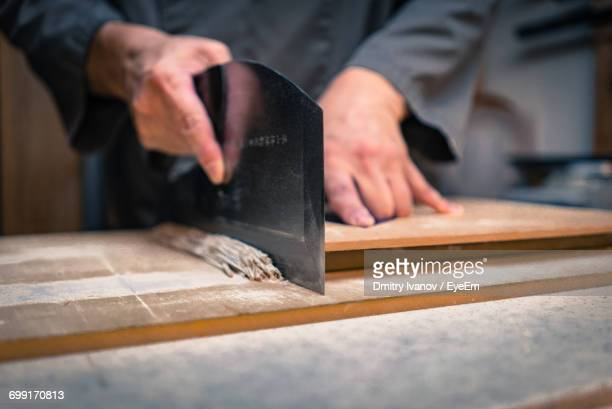 midsection of chef cutting soba noodles on table - soba stock pictures, royalty-free photos & images