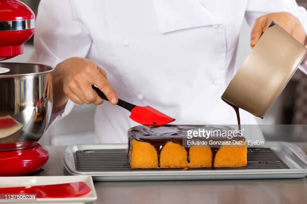 midsection of chef making cake - dessert topping stock pictures, royalty-free photos & images