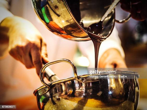 midsection of chef preparing food - chocolate making stock pictures, royalty-free photos & images