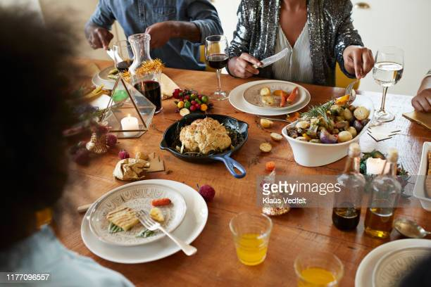 midsection of couple having lunch on dining table - lunch stock pictures, royalty-free photos & images