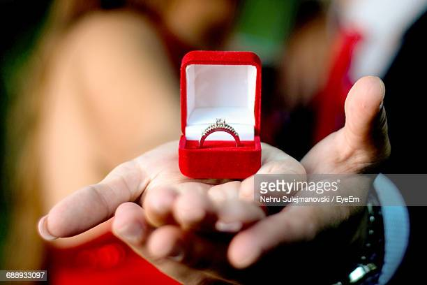 midsection of couple showing engagement ring on palm - engagement ring box stock photos and pictures