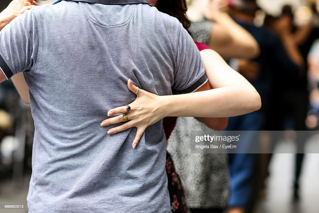 Midsection Of Couple Tangoing On Street : Stock Photo