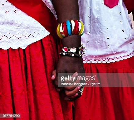 Midsection Of Couple Wearing Red Traditional Clothing