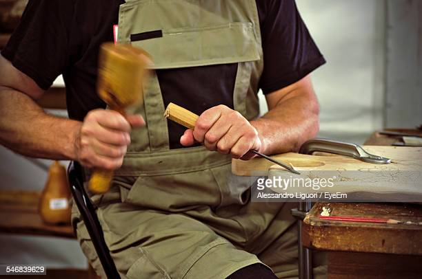 Midsection Of Craftsperson Shaping Wood