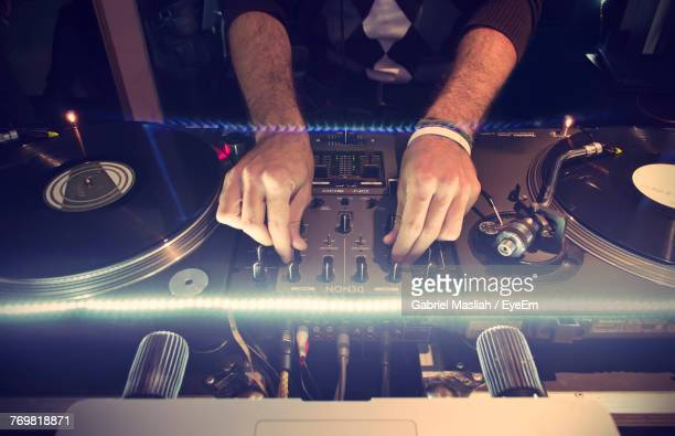 midsection of dj using turntable - deck stock pictures, royalty-free photos & images