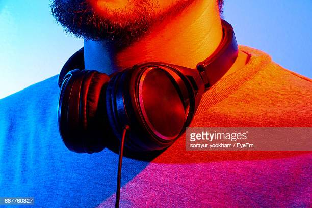 Midsection Of Dj With Headphones