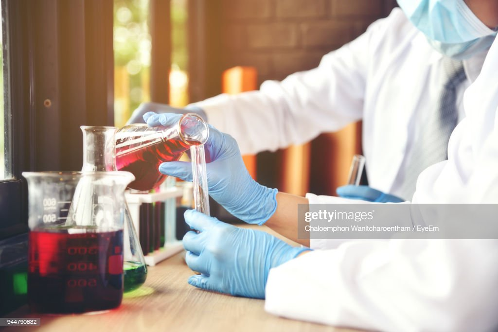 Midsection Of Doctors Working At Laboratory : Stock Photo