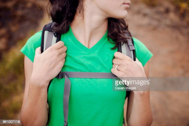 midsection of female hiker carrying backpack - strap stock pictures, royalty-free photos & images