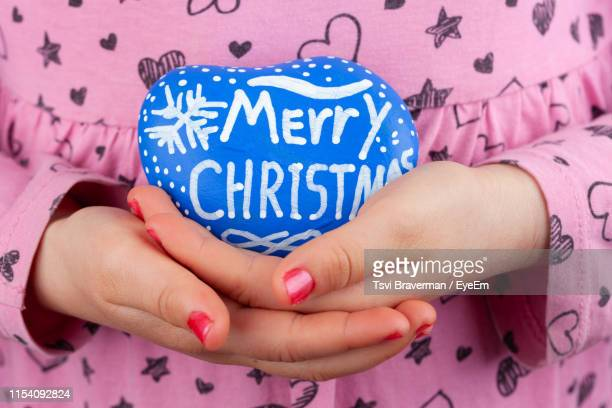 midsection of girl holding easter egg at home - happy holidays stock photos and pictures