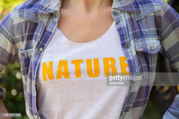 midsection of girl (6-7) wearing nature t-shirt - montclair stockfoto's en -beelden