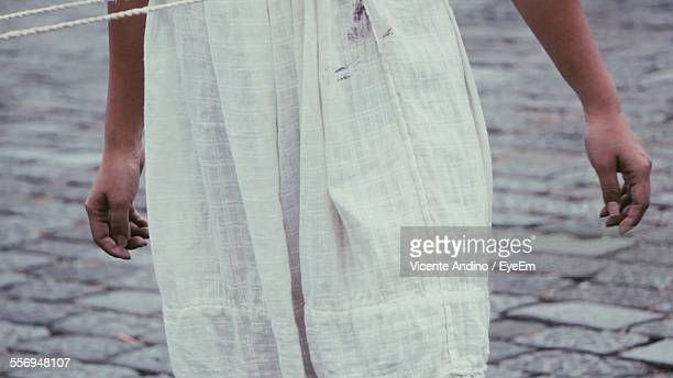 Midsection Of Girl Wearing White Dress On Street