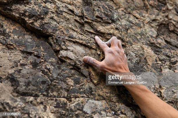 midsection of human hand on rock - chalk rock stock pictures, royalty-free photos & images