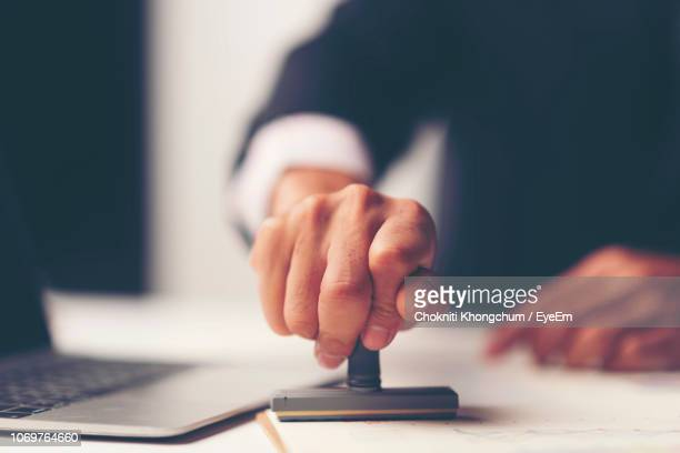 Midsection Of Lawyer Working At Desk In Office