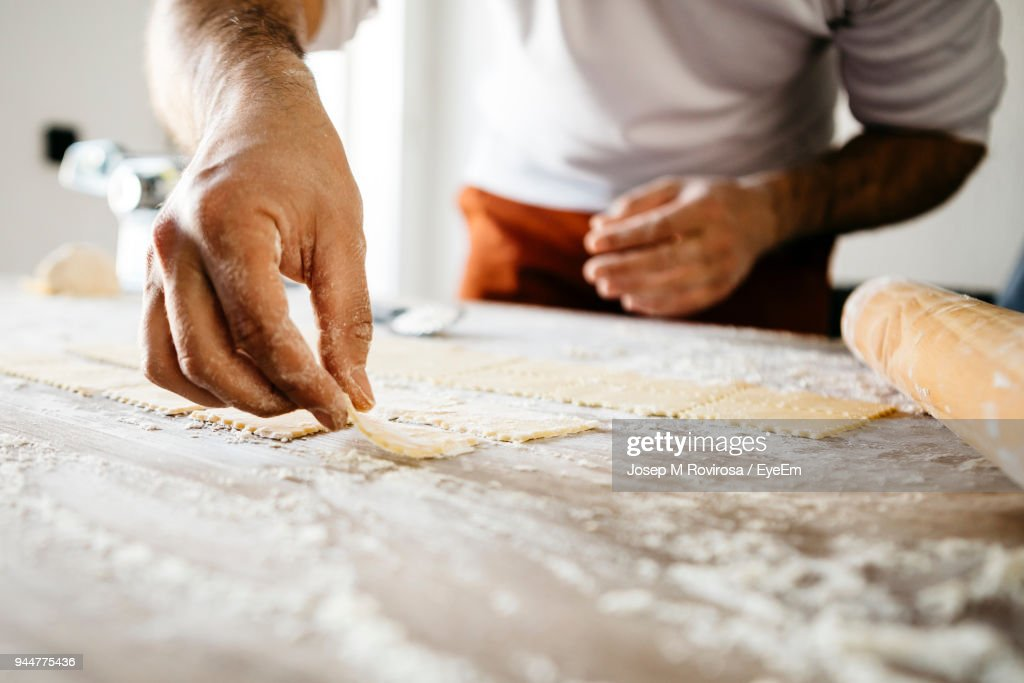 Midsection Of Male Chef Preparing Food On Table : Stock Photo