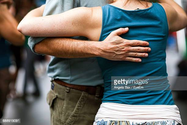 Midsection Of Man And Woman Dancing Tango