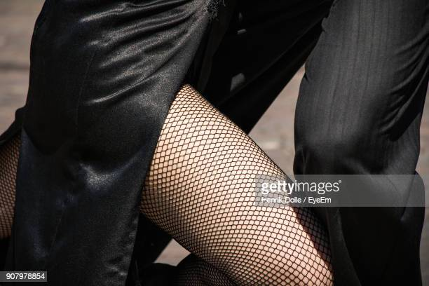 midsection of man and woman - fishnet stockings stock pictures, royalty-free photos & images