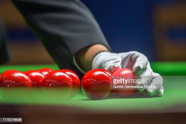 midsection of man arranging pool balls on table - snooker stock pictures, royalty-free photos & images