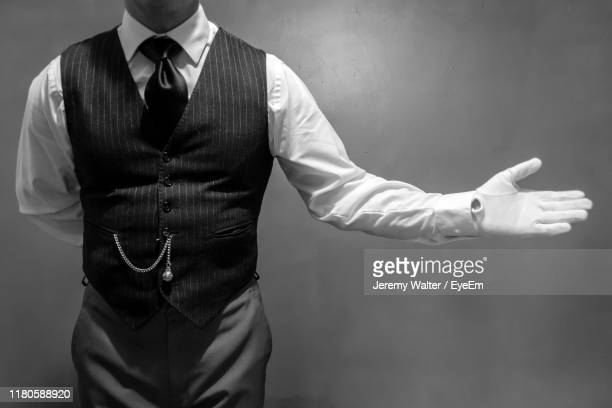 midsection of man gesturing while standing against wall - eyeem jeremy walter stock pictures, royalty-free photos & images