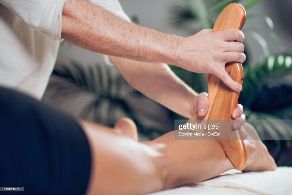 man giving massage to woman