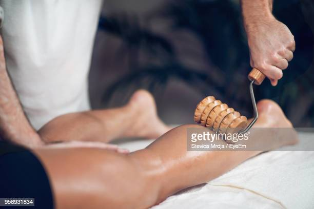 Midsection Of Man Giving Massage To Woman