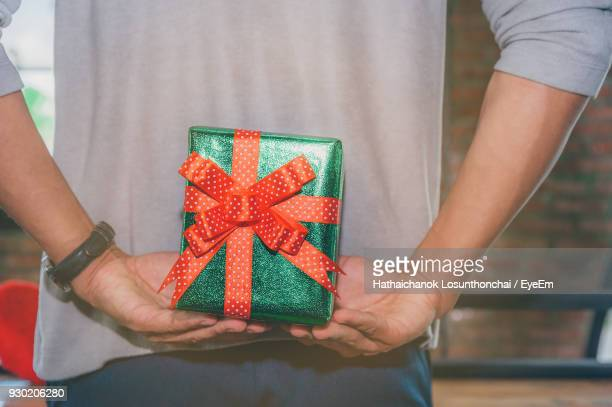 Midsection Of Man Holding Birthday Present