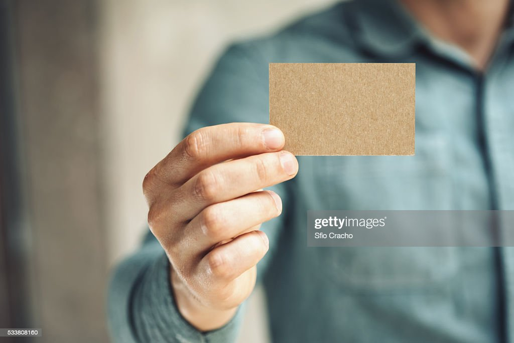 Mid-section of man holding business card : Foto stock