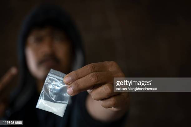 midsection of man holding cocaine - drug dealer stock pictures, royalty-free photos & images