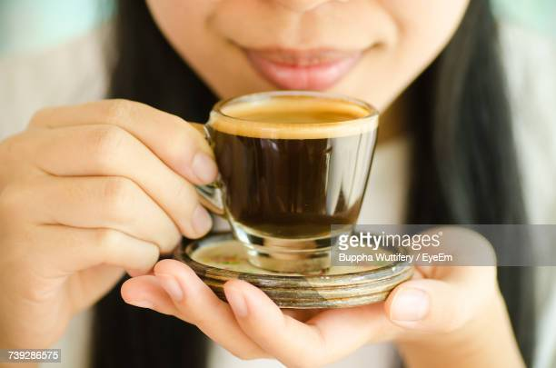 midsection of man holding espresso coffee cup - espresso stock pictures, royalty-free photos & images