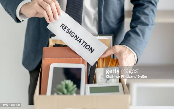 midsection of man holding paper - quitting a job stock pictures, royalty-free photos & images