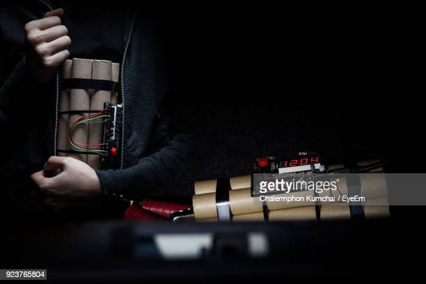 midsection of man holding time bomb - time bomb stock photos and pictures